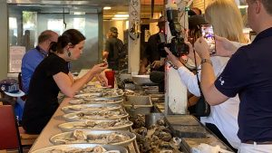 Before discussing how federal regulations impact his small business, the owner of Wintzell's invited Advocacy staff to witness a woman take on the Wintzell's oyster eating challenge to beat a record that stood for 22 years.