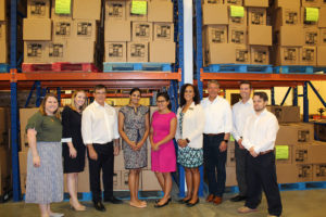 Advocacy staff pitches in at the Food Bank of Northeast Arkansas.